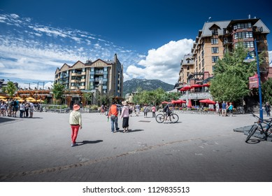 WHISTLER, BRITISH COLUMBIA, CANADA - August 11, 2016: People at street of Whistler, co-host of the 2010 Olympic Games. It is a Canadian resort town 125 km north of Vancouver.