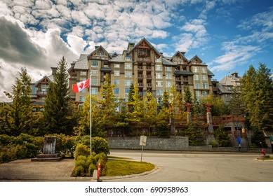 WHISTLER, BRITISH COLUMBIA, CANADA - JULY 2, 2017 : Pan Pacific, a modern condo style hotel in Whistler Village, Canada. Whistler is a canadian resort town visited by over 2 million people annually.