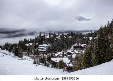Whistler, British Columbia, Canada. Residential Homes on the Mountain during a cloudy and foggy winter day.