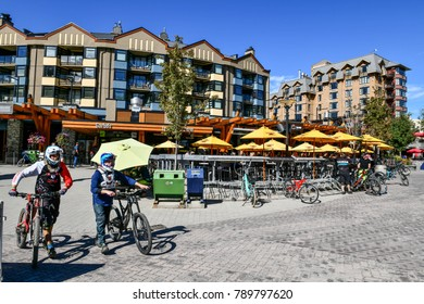 Whistler Village in British Columbia ,Canada - September 26, 2017: Biker riding a mountain bike in the Whistler, It is a Canadian resort town 125 km north of Vancouver.