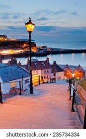 Whitby 199 steps at sunset with street lights lighting up