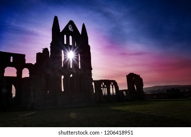 Whitby Abbey with light shing through gothic window