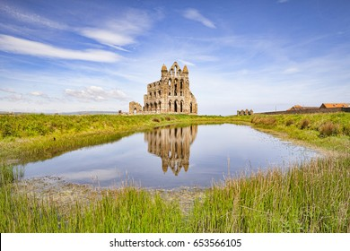 Whitby Abbey, Whitby, North Yorkshire, reflected in a pool.