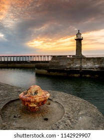 Whitby east pier with forground interest at sunrise.