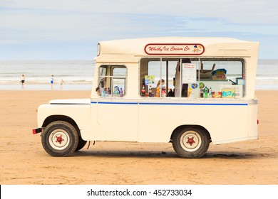 WHITBY, ENGLAND - JULY 12: Woman with children, making a purchase from 'Whitby Ice Cream Co' ice cream van on the beach. In Whitby, North Yorkshire, England. On 12th July 2016.