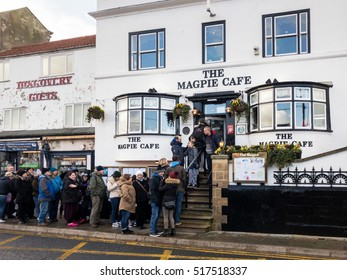 WHITBY, ENGLAND - NOVEMBER 5: People queuing outside famous Magpie Cafe. In Whitby, North Yorkshire, England. On 5th November 2016.