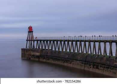 Whitby harbour entrance, east pier and beacon, North Yorkshire, England.