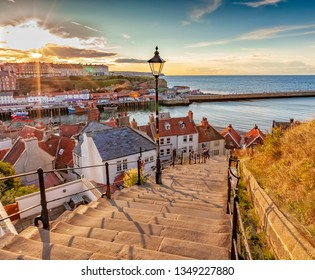 Whitby, North Yorkshire Coast, England 24th August 2018: Famous 199 steps at sunset over the harbour at Whitby
