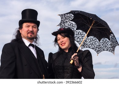 WHITBY, NORTH YORKSHIRE, ENGLAND, UK - OCTOBER 30, 2010: A man and woman dressed in Victorian attire at the Whitby Goth festival in Whitby, North Yorkshire, England UK in October 2010.