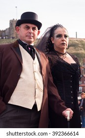 WHITBY, NORTH YORKSHIRE, ENGLAND, UK - OCTOBER 30, 2010: A serious-looking man and woman dressed in Victorian attire at the Whitby Goth Festival in Whitby, North Yorkshire, England UK in October 2010.