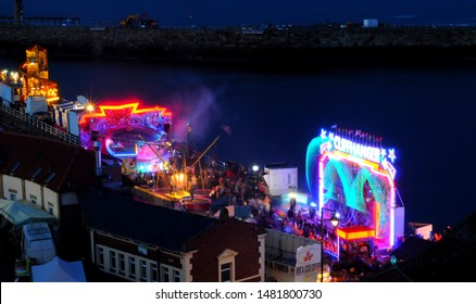 Whitby, North Yorkshire / UK - 08/12/2019: Cliffhanger fairground ride on West Pier during 2019 Whitby Regatta.