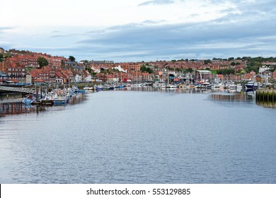 WHITBY, UK - JUNE 30, 2016: The harbor in the port of Whitby on the North Yorkshire coast. Tourism started in Whitby during the Georgian period and developed further on the arrival of railway in 1839.