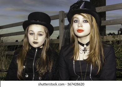 Whitby, UK - November 1, 2014: Whitby Goth Weekend, often abbreviated to WGW is a twice-yearly music festival for goths, in Whitby, North Yorkshire, England.  Young girls in goth costumes