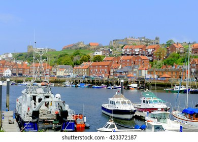 """WHITBY, YORKSHIRE, UK. MAY 12, 2016.  Looking across the river """"Esk"""" towards the old town at Whitby in North Yorkshire, UK."""