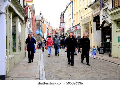 Whitby, Yorkshire, UK. May 15, 2014.  A busy Church Street in the old part of the town of Whitby in North Yorkshire.