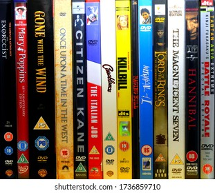 Whitchurch, Shropshire/UK – 5 18 2020:  A random selection of lined-up DVD discs of classic movies from various film genres.