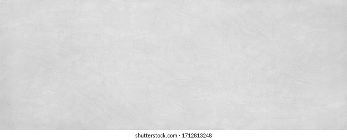 White abstract background. Grunge banner. Texture of plastered concrete wall. Light gray cement background.