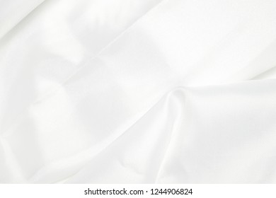 White abstract background luxury cloth, abstract background luxury cloth or liquid wave or wavy folds of grunge silk texture satin velvet material.