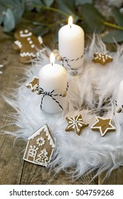 white advent wreath with decoration, two candles