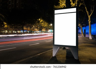 White advertisement lightbox at night. Mock-up. Horizontal. Blank space for content with light trails of moving cars