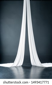 white aerial silks isolated on black background