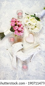 White aesthetic wedding bridal theme desktop workspace with high heel shoes, bouquets and accessories on stylish white textured background. Top view blog hero header creative composition flat lay.