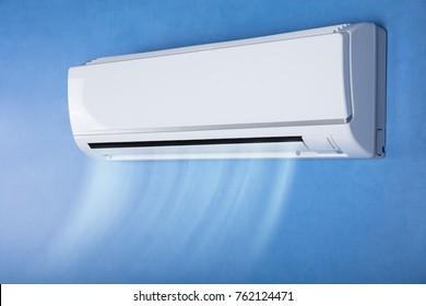 White Air Conditioner On Wall In Living Room