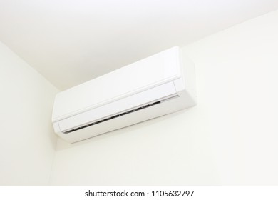 White air conditioner in a room
