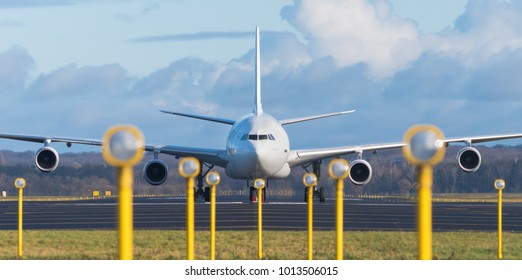white airbus A340-300 at the end of the runway