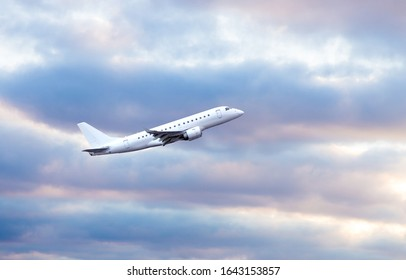 white aircraft in flight on cloudy sky background.