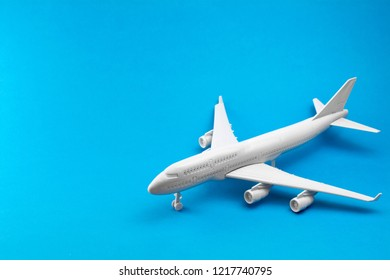 white airplane on a blue background. minimal trip and travel creative concept