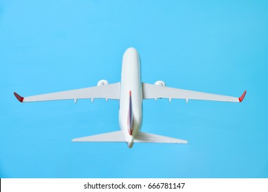 white airplane on a blue background, back view