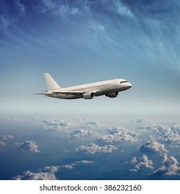 White airplane on a blue sky