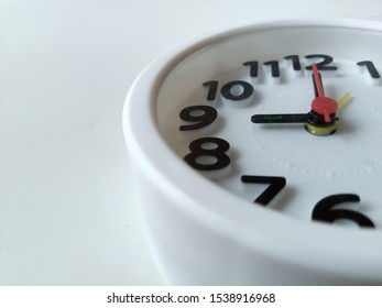 White alarm clock on the desk, 9 o'clock in the morning, Office business concepts.
