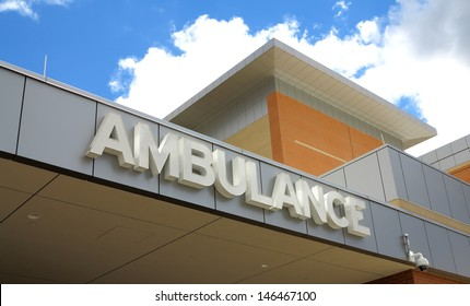White ambulance sign on the side of a hospital
