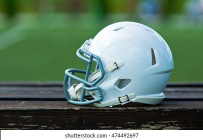 White american football helmet at the playing field
