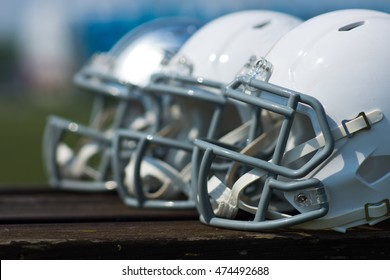 White american football helmets at the playing field