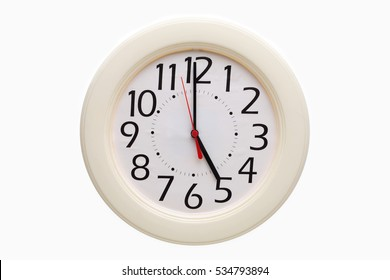 White analog wall clock showing 5:00 o'clock on white background