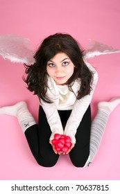 White angel girl with small red hearts in the hand