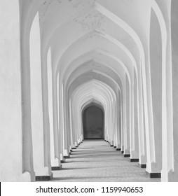 White Arabian arches in Kolon mosque. Bukhara. Uzbekistan. Central Asia.