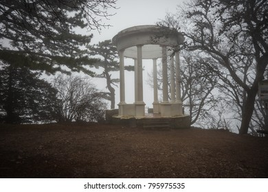 White arbor with columns on Mount Ai Petri among  clouds and fog in Crimea, Russia