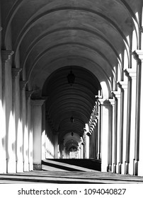 white arches and the staircase leading to a sanctuary in Vicenza Italy with black and white effect