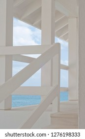 White architectural detail of caribbean house and sea in the background
