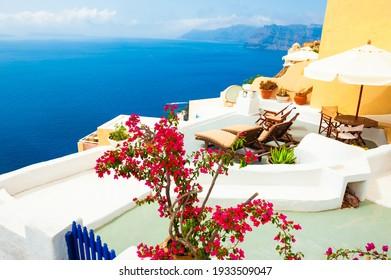 White architecture and blue sea on Santorini island, Greece. Beautiful terrace with sea view.