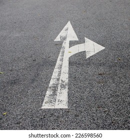 white arrow on old road