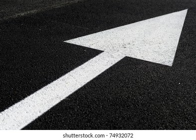 a white arrow on the road