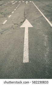 white arrow on the road, go to forward