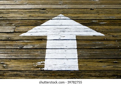 White Arrow Painted on Wooden Planks