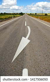 White arrow turning to right painted on the road asphalt. Recommendation traffic sign