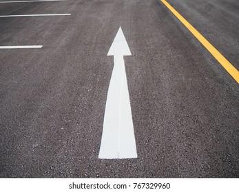 White arrows on the street